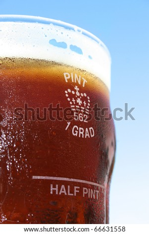 The Grand Old 1 Grad Pint Glass Filled With Pure Ice Cold Golden Ale Bliss - stock photo