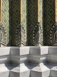 the grand palace wat phra kaew ancient temple in bangkok, at the base of chedi, thai ceramic mosaic