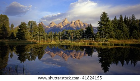 The Grand Teton Mountain Range reflecting in a beaver pond at Schwabackers Landing in Grand Teton National Park, located in Wyoming.