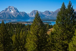 The Grand Teton range, with Mt. Moran at left, rises sharply above Jackson Lake, as seen from an overlook on Signal Mountain, a scenic point in the national park.