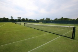 The grass tennis court in country club