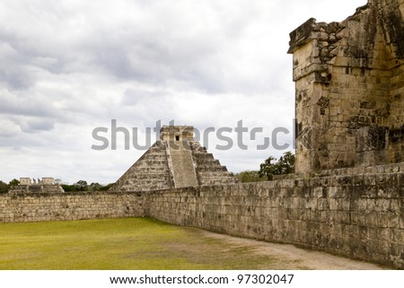 The Great Ball Court with El Castillo and the Temple of Warriors on the background. All part of the Maya archaeological site of Chichen Itza in Yucatan, Mexico.