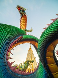 The great Naga or serpent statue has beautiful colors and has sky background. Ancient animal statues according to Buddhist beliefs.Phrathat Nong Bua Temple in Ubon Ratchathani,Wat Phra That Nong Bua.
