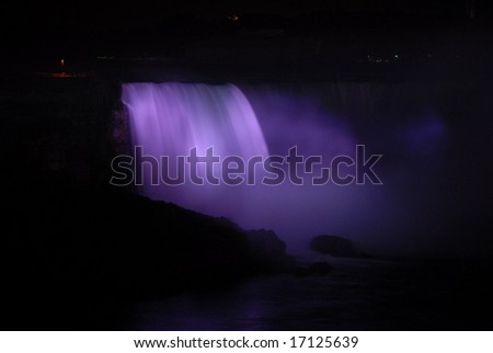 The Great Niagra Falls at night, lit up by colored lights in Canada 6