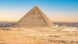 The great pyramid of Cheops in Cairo, Egypt. Ancient Pyramid Against Sky. Pyramid Chufu Cheops - known as the Great Pyramid. Sunset at Cheops in Giza, Egypt