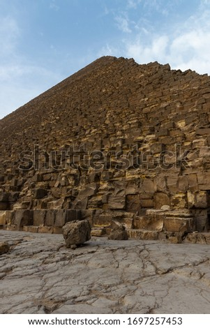 The Great Pyramid of Giza (also known as the Pyramid of Khufu or the Pyramid of Cheops) is the oldest and largest of the three pyramids in the Giza pyramid complex bordering what is now El Giza, Egypt