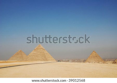 the great pyramids of giza in Egypt with cairo in the background