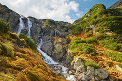The Great Siklawa Waterfall (70 m high) on Roztoka Stream. The High Tatra Mountains, Carpathians. Valley of Five Polish Ponds. Amazing nature reserve in Poland.