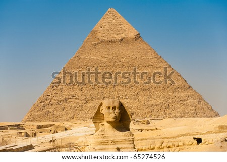 The Great Sphinx aligned perfectly center and symmetric of the biggest of the great pyramids, the Pyramid of Khafre in Giza, Cairo, Egypt. Horizontal copy space