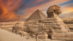 The Great Sphinx of Giza, is a limestone statue of a reclining sphinx, a mythical creature. It stands on the Giza Plateau on the west bank of the Nile in Giza, Egypt