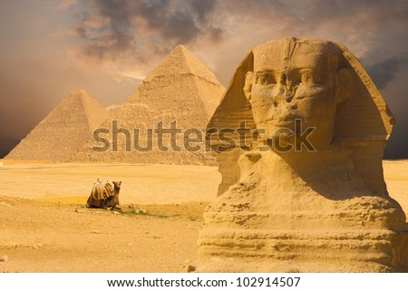 The Great Sphinx's face with a set of pyramids in the background and a beautiful purple sunset sky day in Giza, Cairo, Egypt