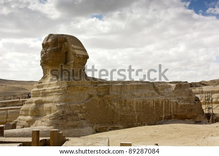 The Great Sphinx statue at Giza with white clouds behind