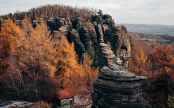 The Great Tisa Rocks or Tisa walls in Bohemian Switzerland autumn fall dramatic view landscape in Czech-Saxon Switzerland, Czech Republic.  It is the region with rock pillars up to 30 m high.