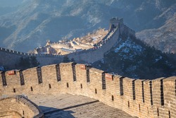 The Great wall of China at Badaling site in Beijing, China (Chinese language translations are on the same plates that hung on the wall)