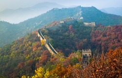 the great Wall of China in autumn at sunset