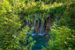 The Great Waterfall at Plitvice Lakes National Park in Croatia. Beautiful water cascade with river and lakes, popular tourist attraction worldwide. Stunning green waterfall in a forest in the summer