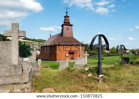 The Greek Catholic wooden church of St Lucas the Evangelist located at cemetery in Krive, Slovakia - stock photo