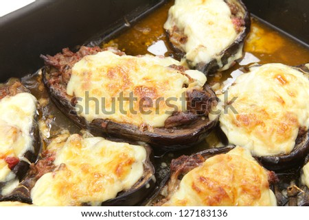The Greek dish of aubergines stuffed with minced beef, onion and tomatoes, topped with bechamel sauce and cheese, fresh from the oven.