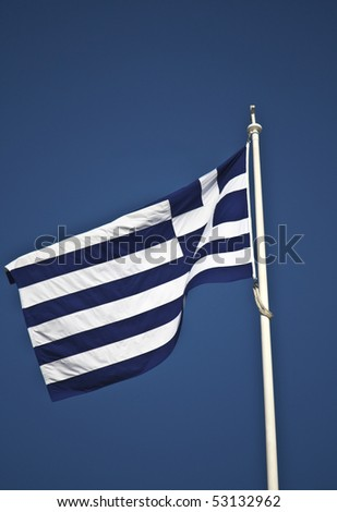 The Greek national flag at the top of the Greek Parliament