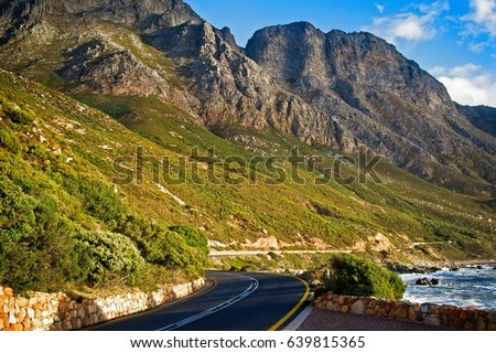 The green and rocky hilly slopes along the beautiful and scenic coastal road of the Garden Route, Cape Town, South Africa. #639815365
