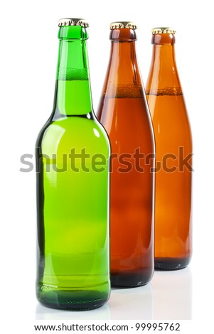 The green and two brown bottles of beer on white background