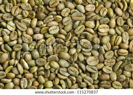 the green coffee beans background - stock photo