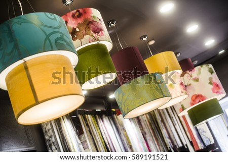 The green fabric lampshade at the magazine. colorful, decorative, electrical, furniture, illumination, lamp, lampshade, style, textile, abstract background, hanging lamp, interior design - Shutterstock ID 589191521
