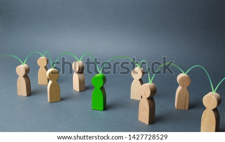 The green figure of a person unites other people around him. Social connections, communication. Organization. Call for cooperation, creating a new team. Leader and leadership, coordination and action,