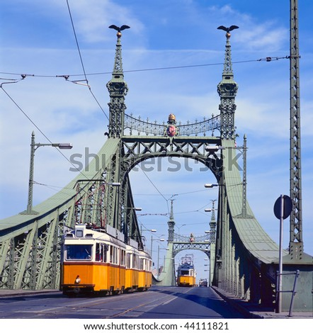 The green Freedom Bridge, with yellow tram, in Budapest,the capital of Hungary - stock photo