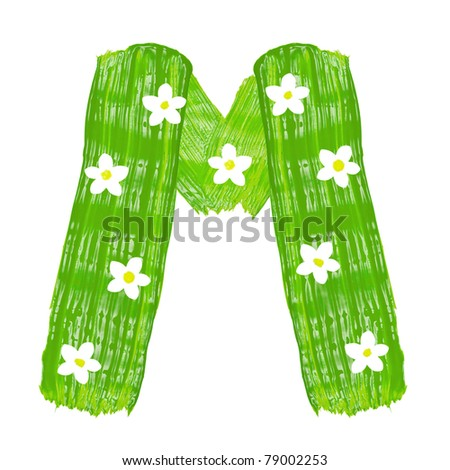 The green letters M drawn by paints with white blossom