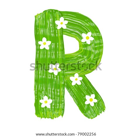 The green letters R drawn by paints with white blossom