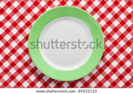 the green plate on checkered tablecloth