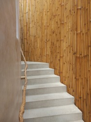 The grey concrete stair/steps to the first floor in the wooden house in Bali, Indonesia