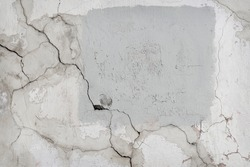 The grey texture of a ruined wall
