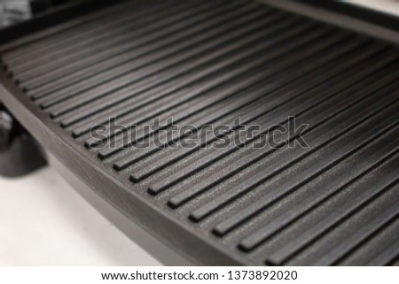 The grill surface area of a panini press