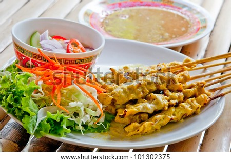 ... pork served with peanut sauce or sweet and sour sauce( moo satay
