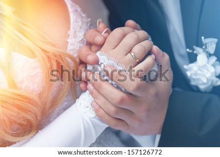 The groom embraces the bride