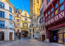 The Gros-Horloge (Great-Clock) is a fourteenth-century astronomical clock in Rouen, Normandy, France. Architecture and landmarks of Rouen. Cozy cityscape of Rouen
