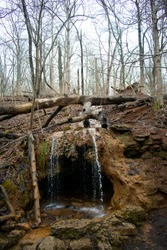 The Grotto at Glen Helen Nature Preserve in Yellow Springs, OH. This is a small waterfall over a small cave. It is a wooded park and is taken during the winter season.