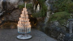 The Grotto of Massabielle is the place where the Virgin appeared to Bernadette Soubirous, a 14-year-old girl, from Lourdes, France, in 1858. At the back left of the Grotto is the Spring.