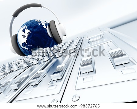 The ground listening music in headphones and the metal control panel