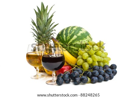 The group of fruits and two glasses of wine isolated on white