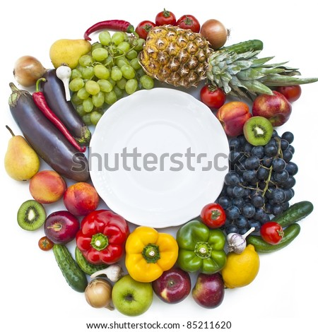 The group of vegetables and fruits with plate on white background - stock photo