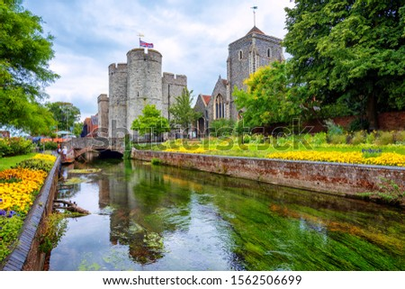 The Guildhall and the Westgate towers seen from the Stour river banks in Canterbury Old town, England, United Kingdom