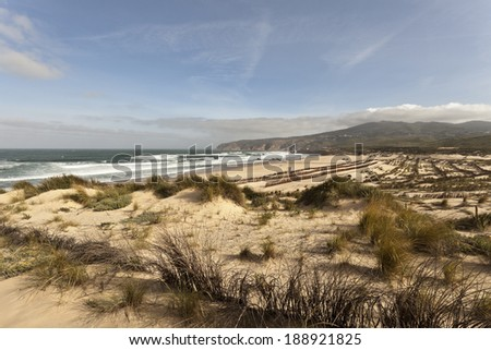 The Guincho Beach near Lisbon, Portugal, is famous for the excellent conditions for wind related sports such as windsurf and kitesurfing.