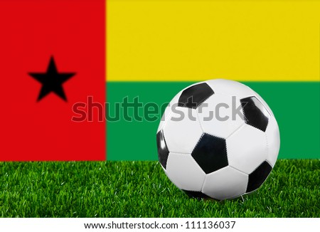 The Guinea-Bissau Flag and soccer ball on the green grass #111136037