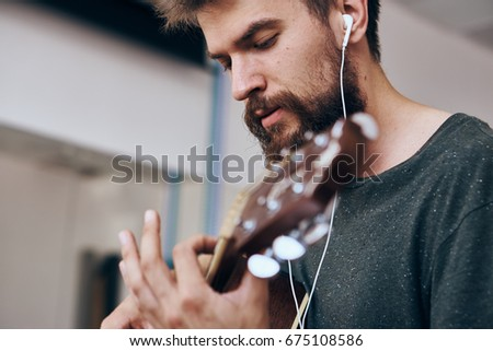 The guitarist is playing                                #675108586