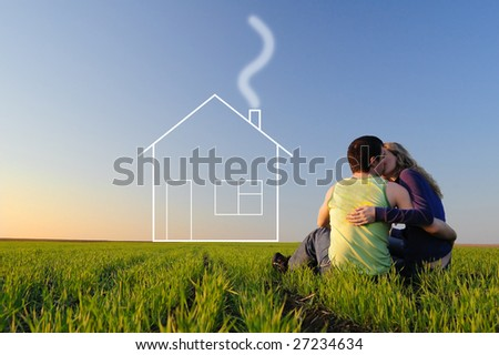 The guy and the girl kiss in a spring field and dreams about the new house
