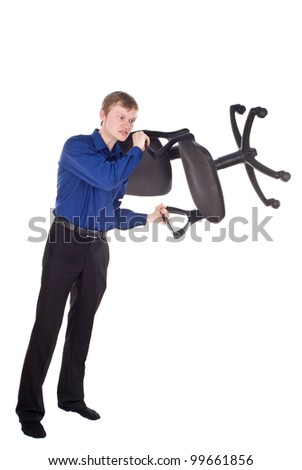 the guy beautiful angry holds the chair isolated on white background