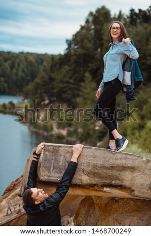 the guy hangs on the edge of the cliff, and the girl arrogantly looks down on him